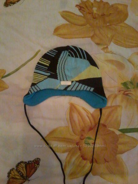 Продам зимнюю шапку Reima