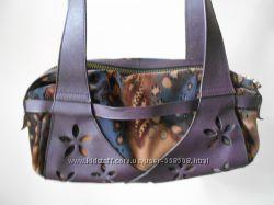 Элегантная фиолетовая сумочка