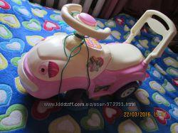 Машинка-толкалка для активной девочки