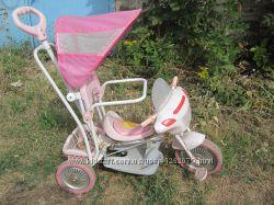 Детский велосипед с качалкой