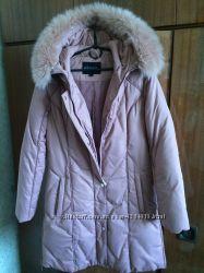 Теплый пуховик розового цвета