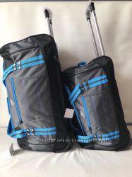 Комплект дорожных сумок на колесах с телескопической выдвижной ручкой