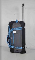 Дорожная сумка на колесах с выдвижной ручкой